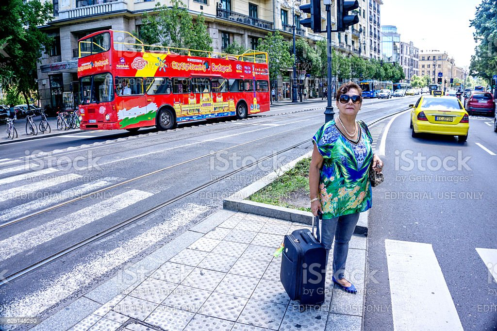 Senior hispanic tourist crossing street in central Budapest stock photo