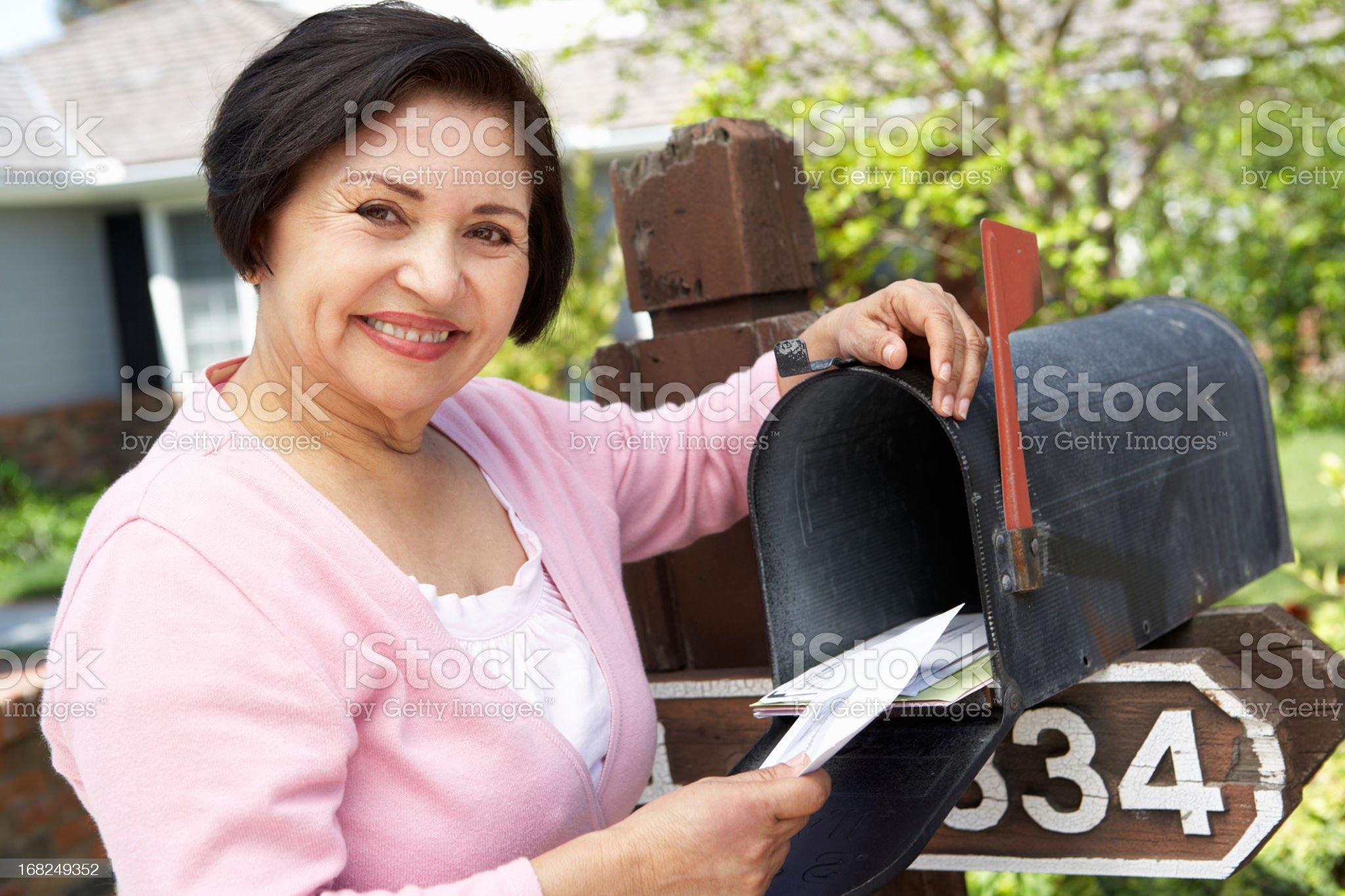 Senior Hispanic Woman Checking Mailbox royalty-free stock photo