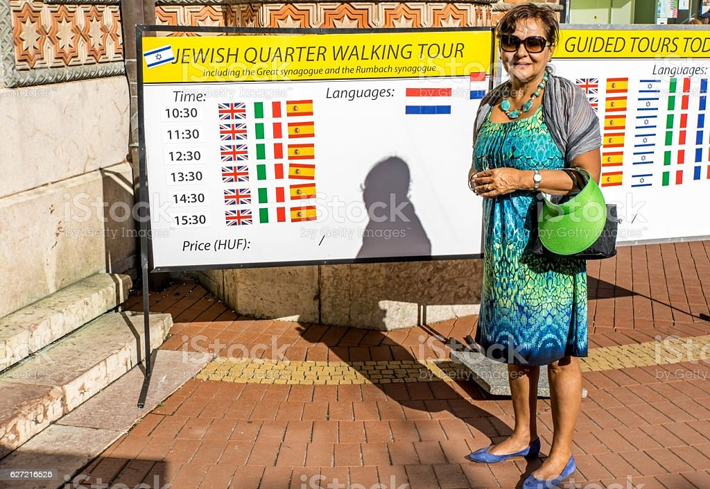 Senior hispanic woman tourist outside Budapest synagogue stock photo