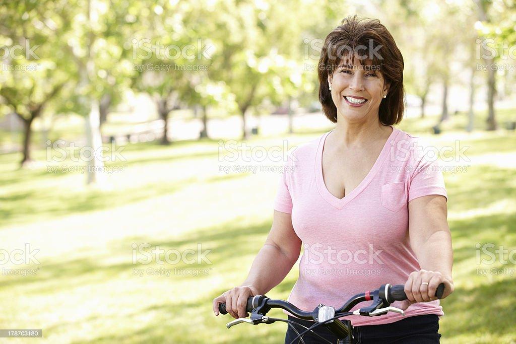 Senior Hispanic woman with bike stock photo