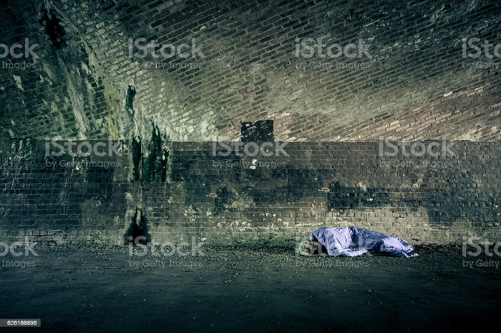 Senior homeless caucasian male sleeping rough outdoors stock photo