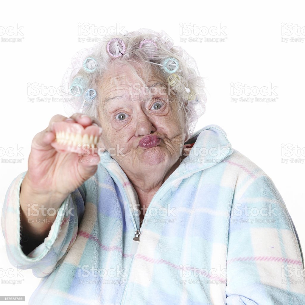 Senior Humor: woman holding false teeth stock photo
