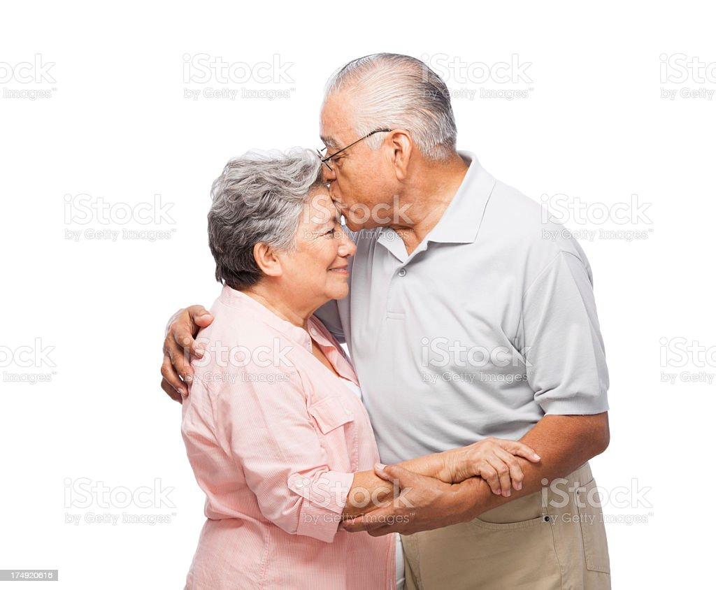 Senior husband kissing his wife royalty-free stock photo