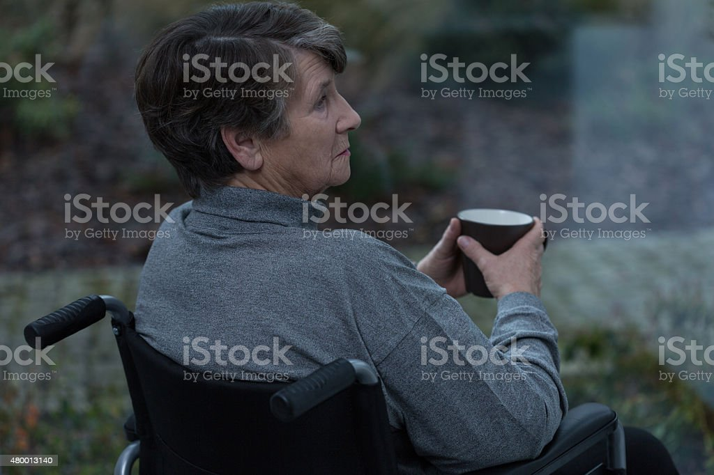 Senior in a wheelchair stock photo