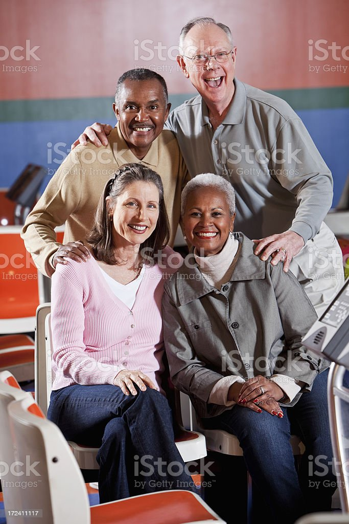 Senior in bowling alley stock photo