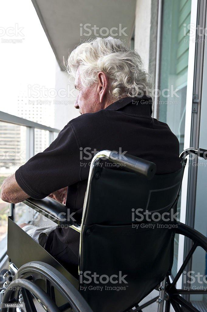Senior in wheelchair stock photo