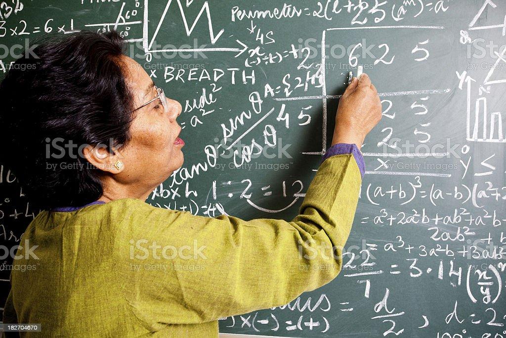 Senior Indian Mathematics Teacher in a Classroom royalty-free stock photo
