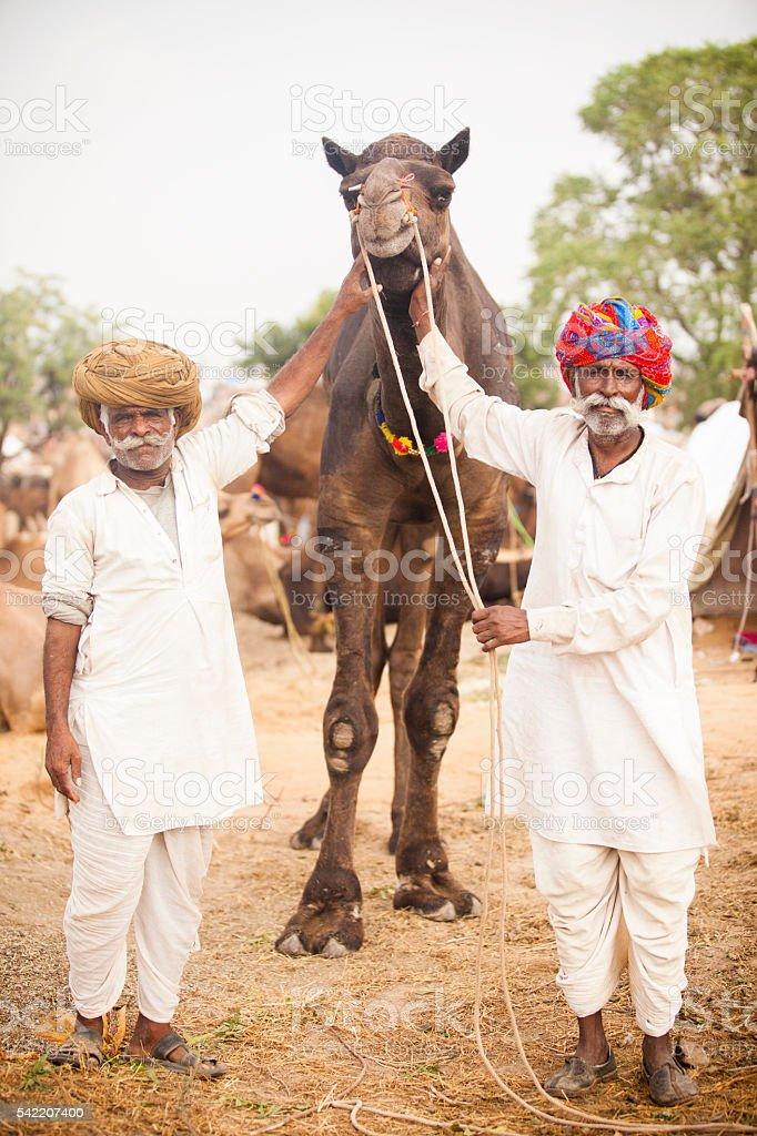 Senior Indian Men Selling Camel stock photo