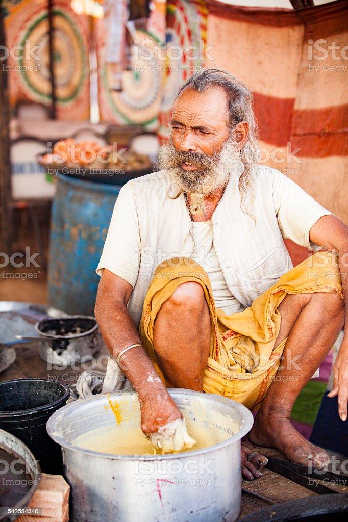 Senior Indian Naan Vendor at Pushkar Camel Fair stock photo