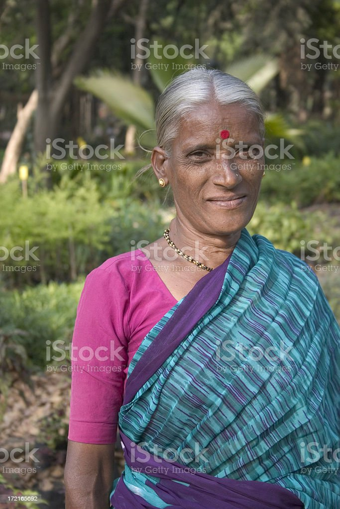 Senior Indian Rural Lady Woman Female Cheerful Vertical Traditional Sari stock photo