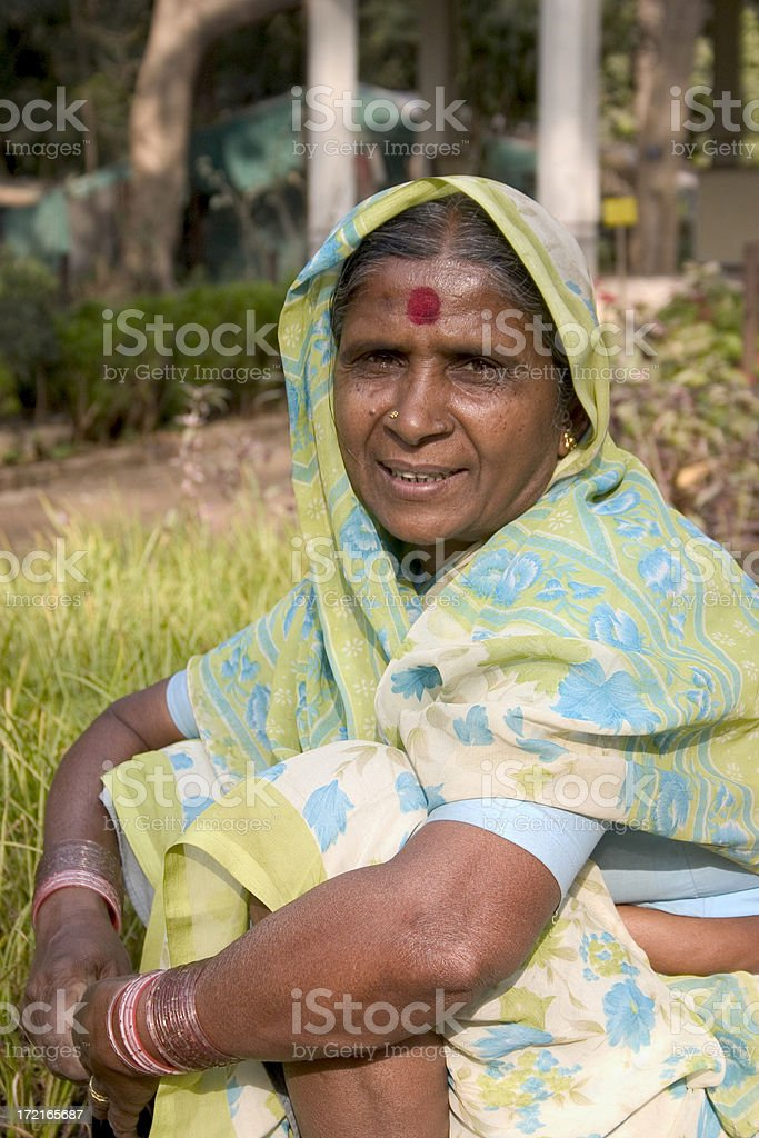 Senior Indian Rural Lady Woman Female sitting Vertical Traditional Sari royalty-free stock photo