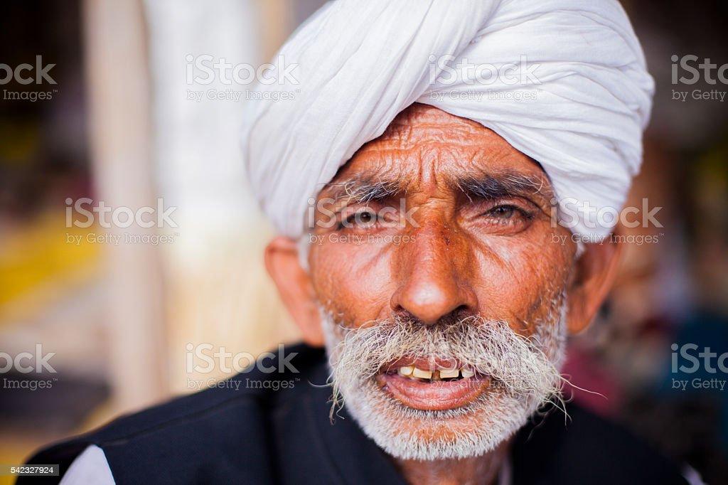 Senior Indian Vendor at Pushkar Camel Fair stock photo