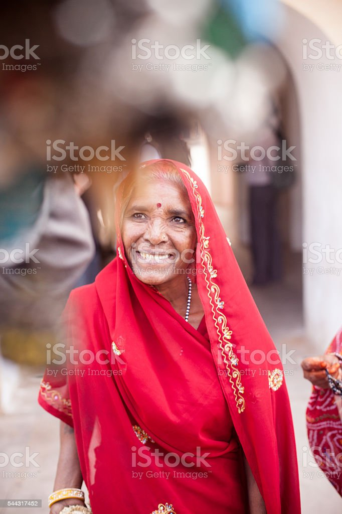 Senior Indian Woman Dressed in Traditional Attire Smiling stock photo