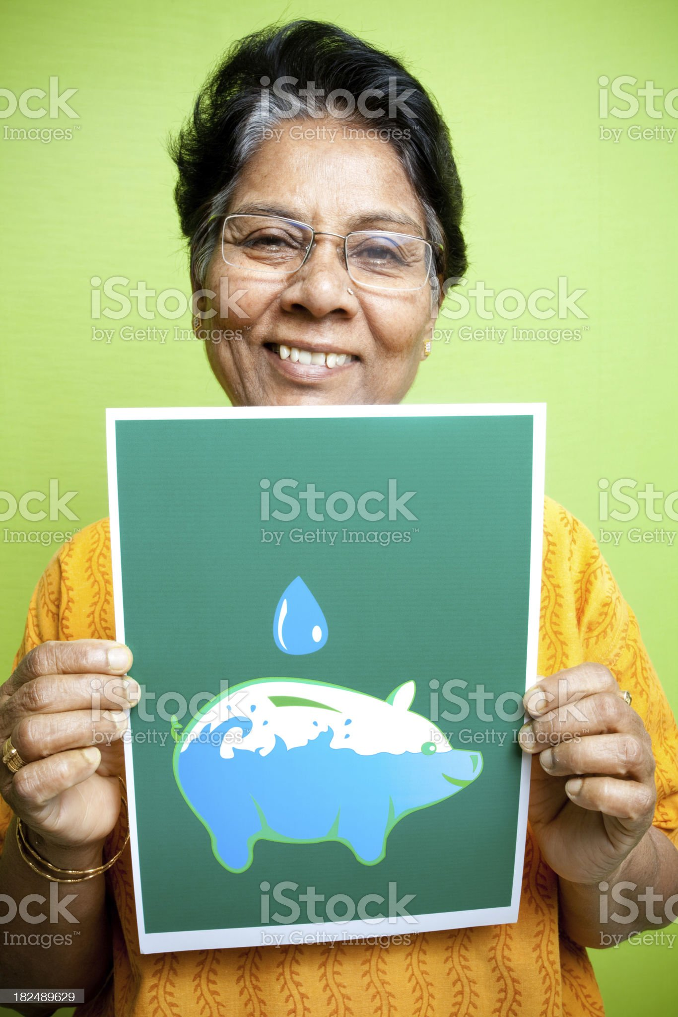 Senior Indian woman showing Save Water message sign poster leaflet royalty-free stock photo