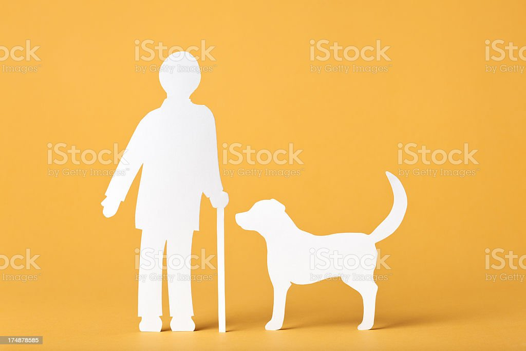Senior interacting with a dog: paper concept royalty-free stock photo