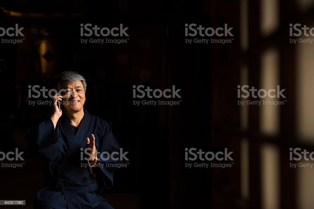 Senior Japanese at a temple stock photo