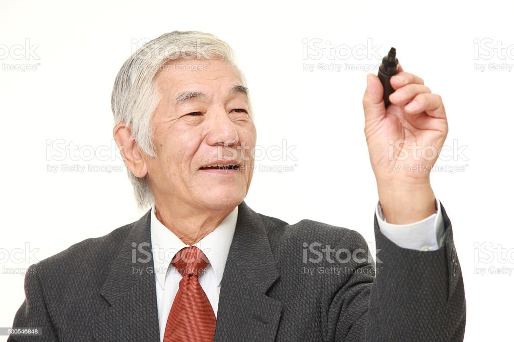 senior Japanese businessman draw in the air stock photo