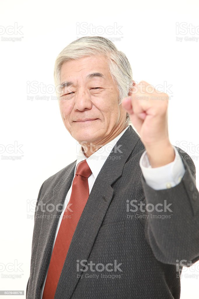 senior Japanese businessman in a victory pose stock photo