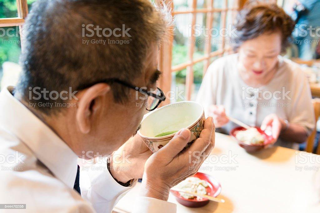 Senior Japanese Couple Eating and Drinking Tea at Cafe Restaurant stock photo