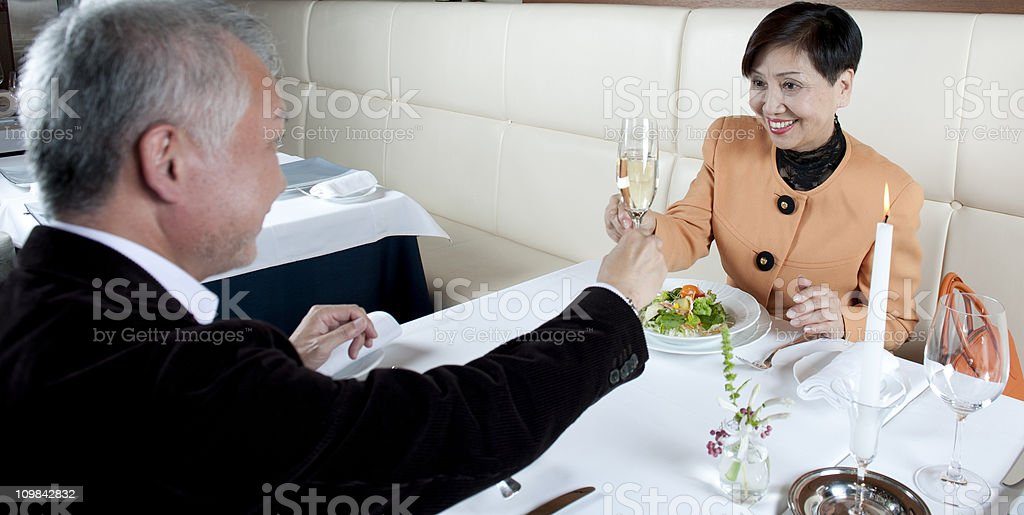 Senior Japanese couple toasting royalty-free stock photo