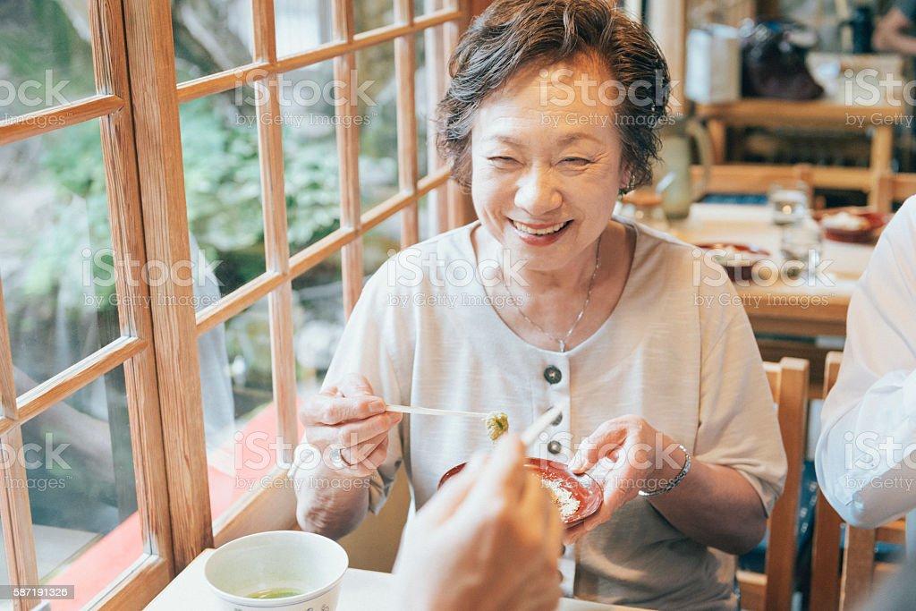 Senior Japanese Friends Enjoying Desert at Restaurant in Kyoto Japan stock photo