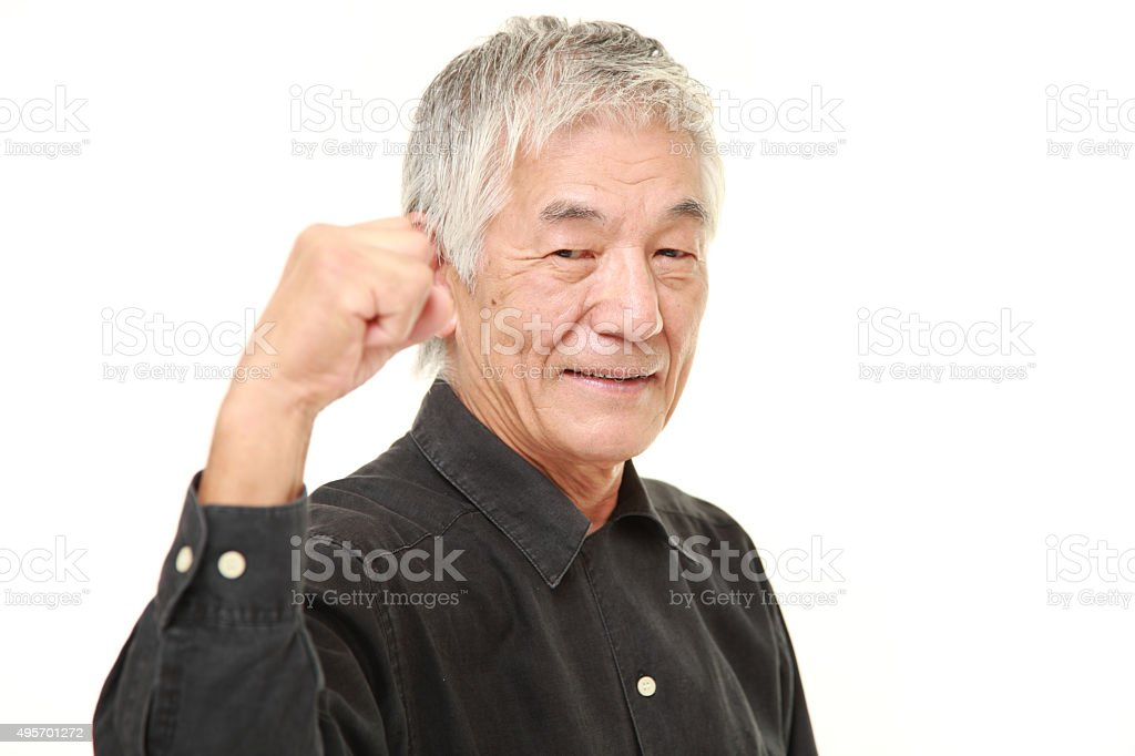 senior Japanese man in a victory pose stock photo