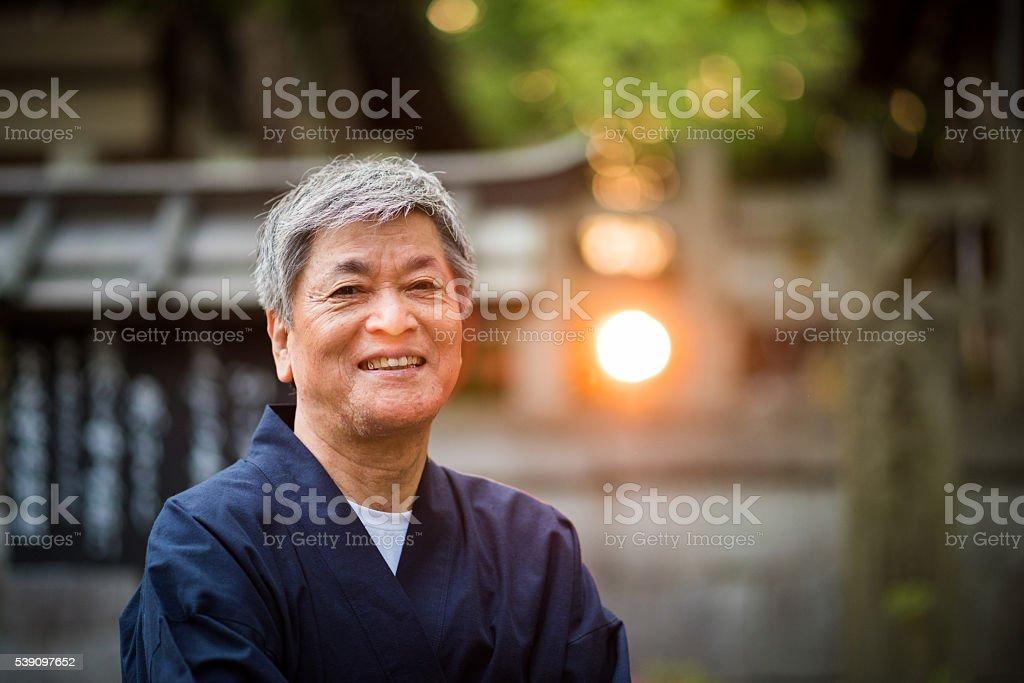 Senior Japanese man in traditional clothing stock photo