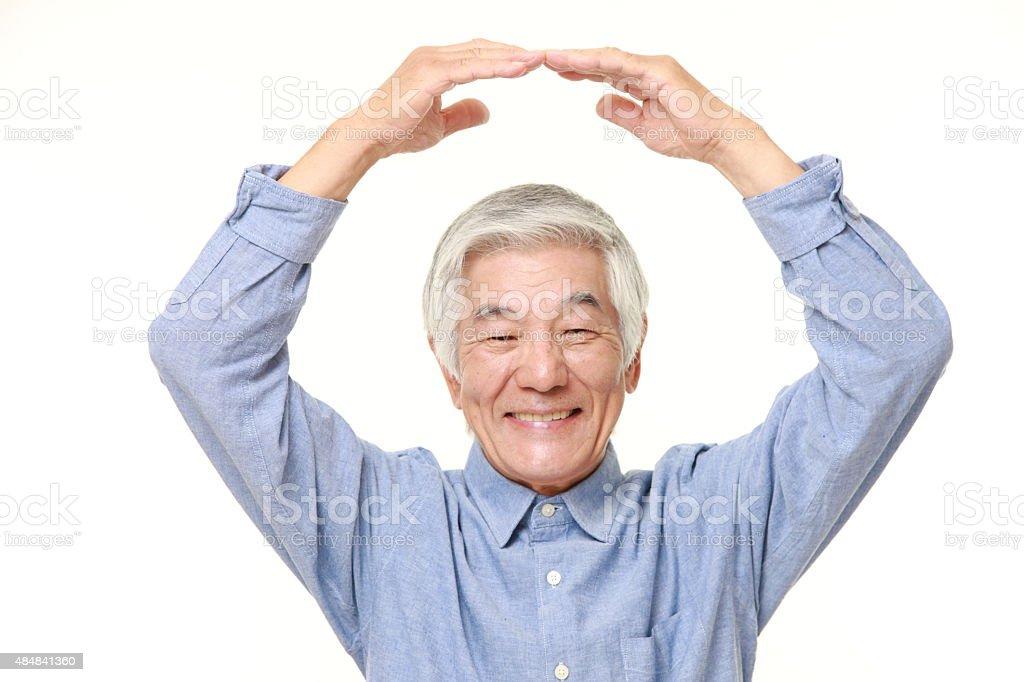 senior Japanese man making OK gesture stock photo