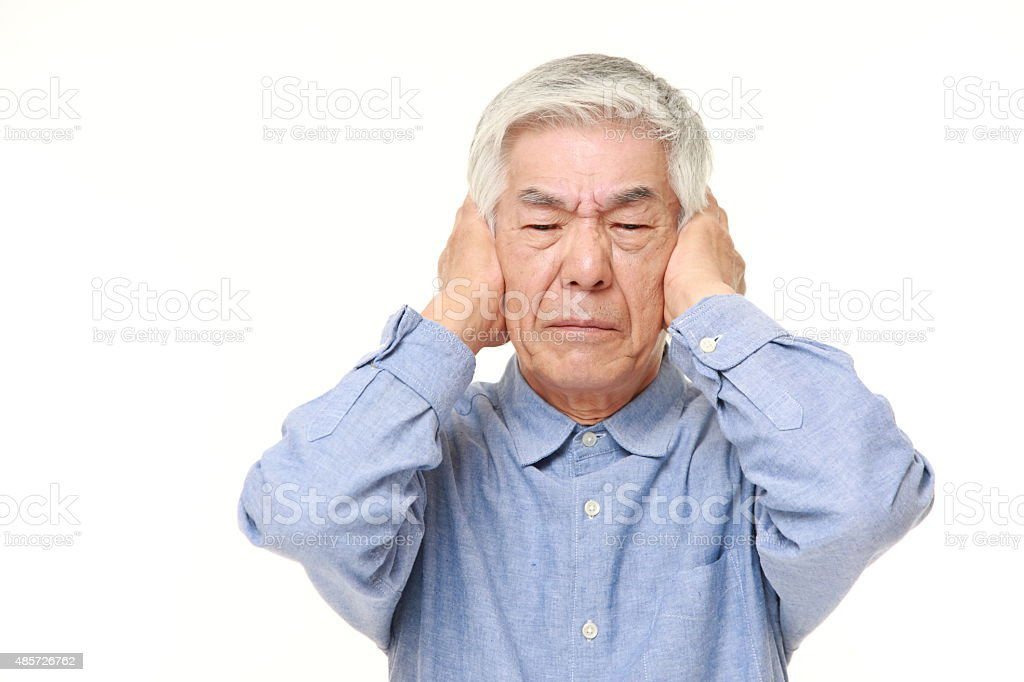 senior Japanese man suffers from noise stock photo