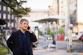 Senior Japanese man using a smart phone