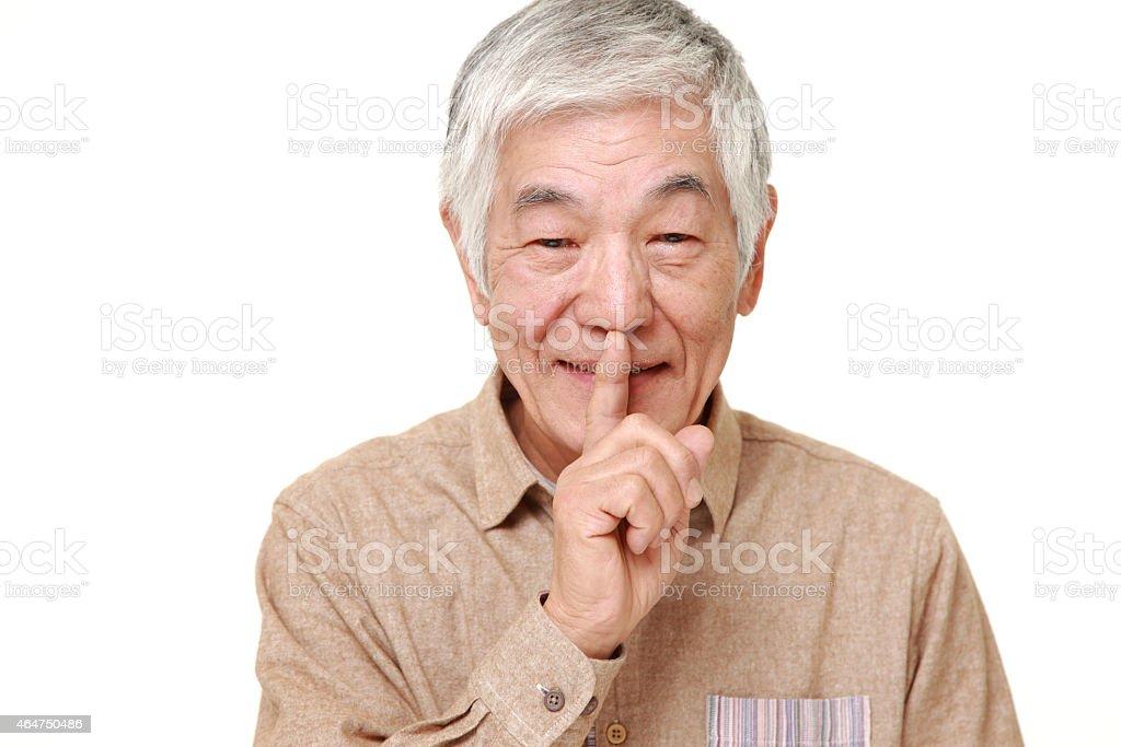 senior Japanese man whith silence gestures stock photo