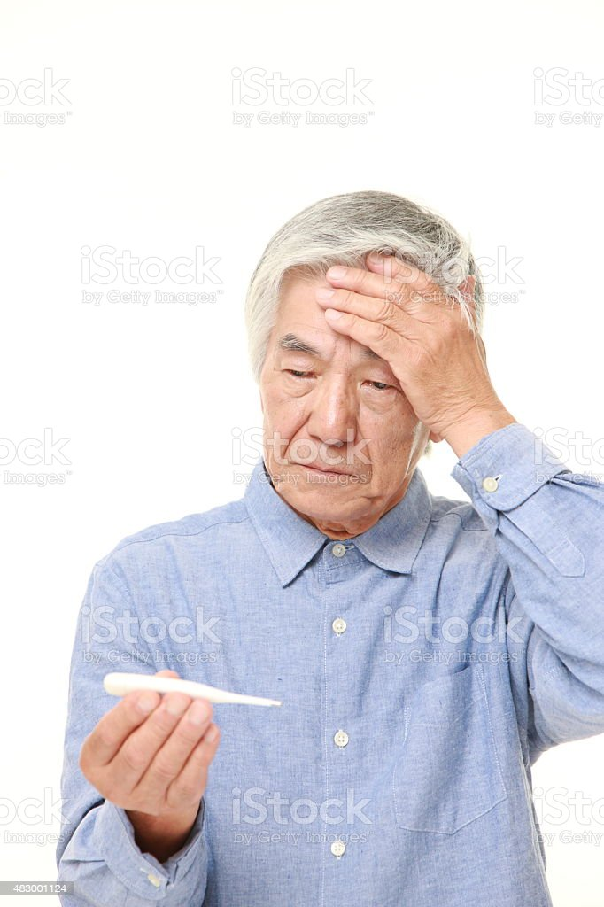 senior Japanese man with fever stock photo