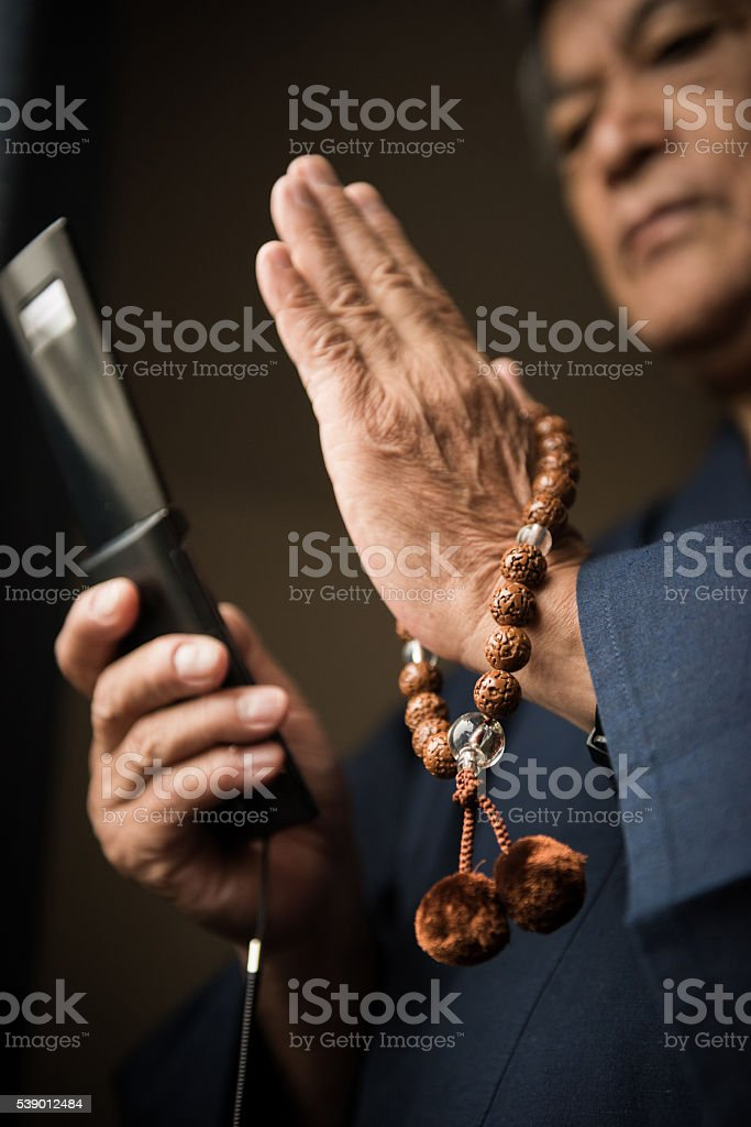 Senior Japanese man with prayer beads stock photo