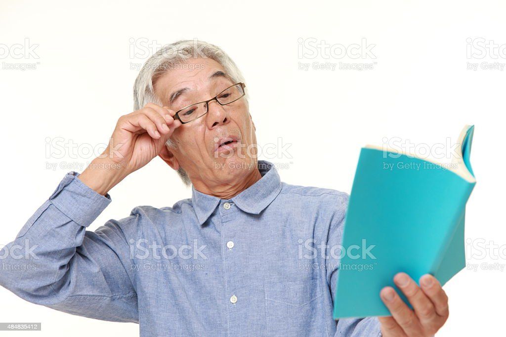 senior Japanese man with presbyopia stock photo