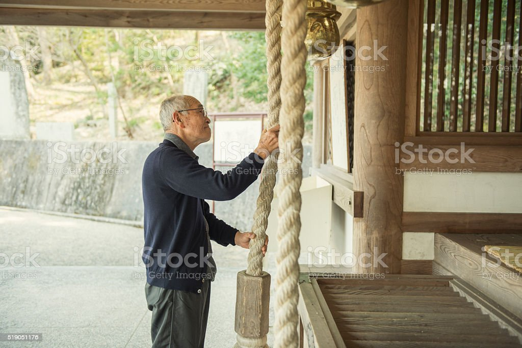 Senior Japanese men are worshiped in the shrine stock photo