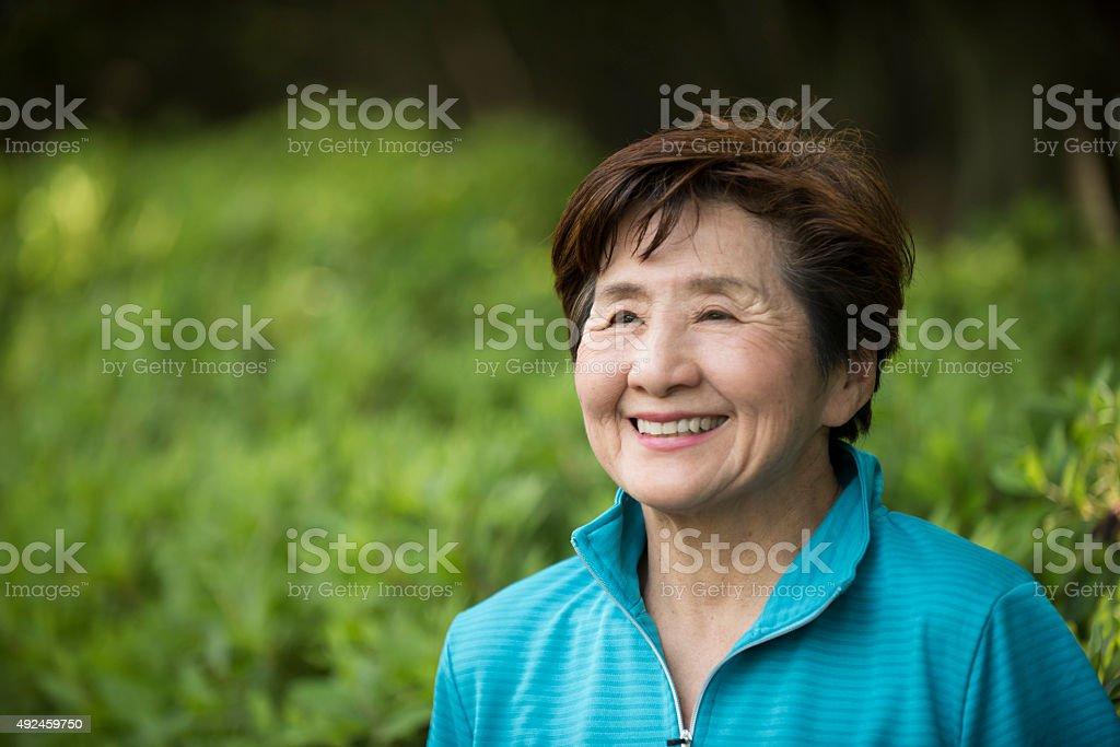 Senior Japanese woman smiling stock photo