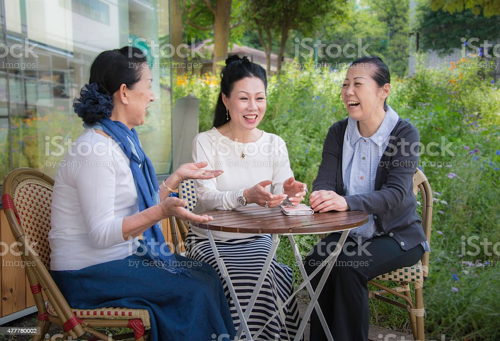 Senior Japanese women chatting in a cafe royalty-free stock photo