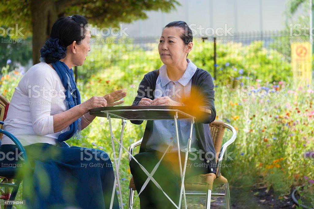 Senior Japanese women chatting in Cafe royalty-free stock photo