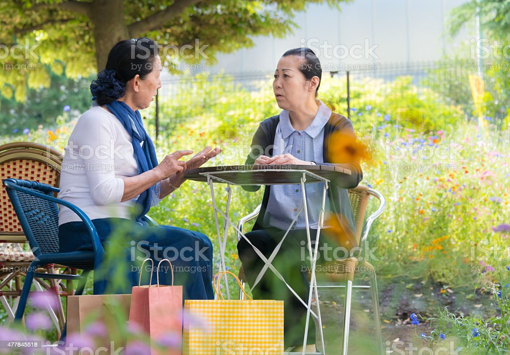 Senior Japanese women chatting in Cafe royalty-free stock photo