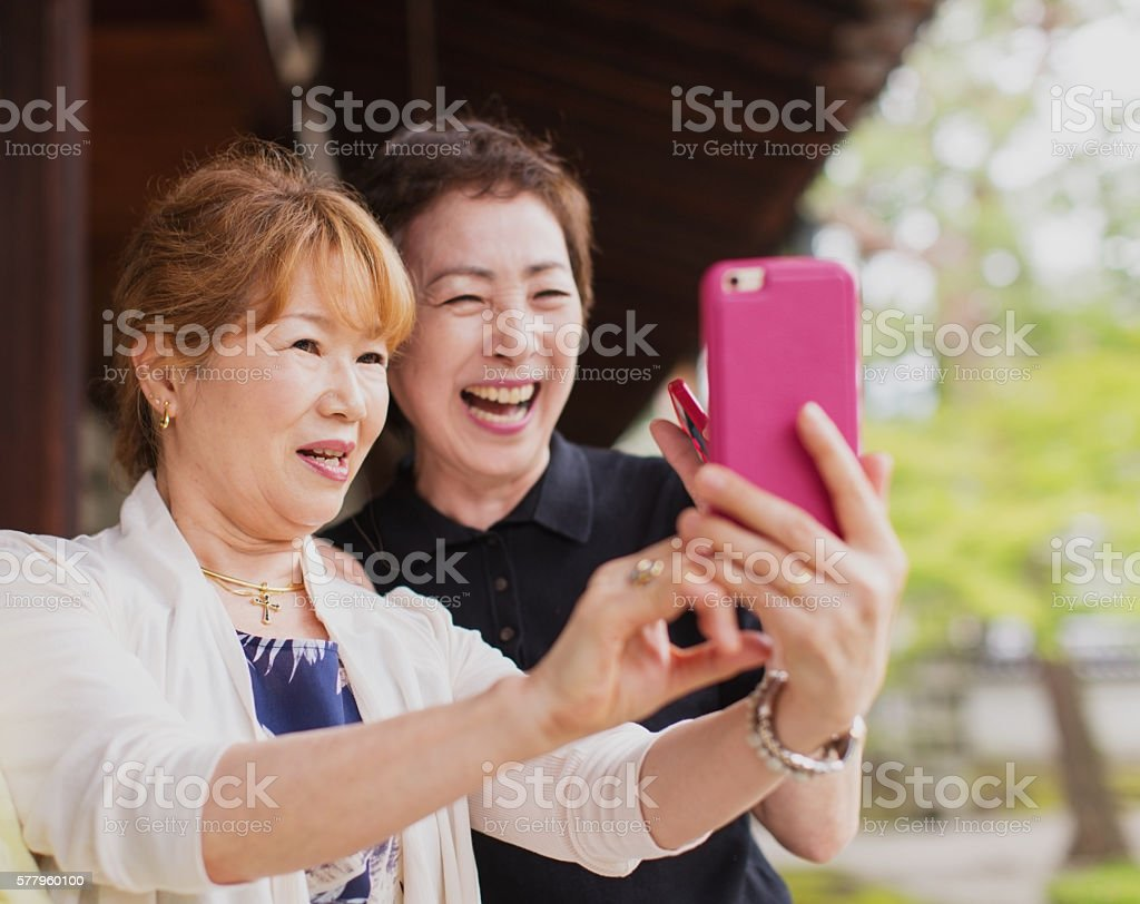 Senior Japanese Women Taking Pictures with Phone stock photo