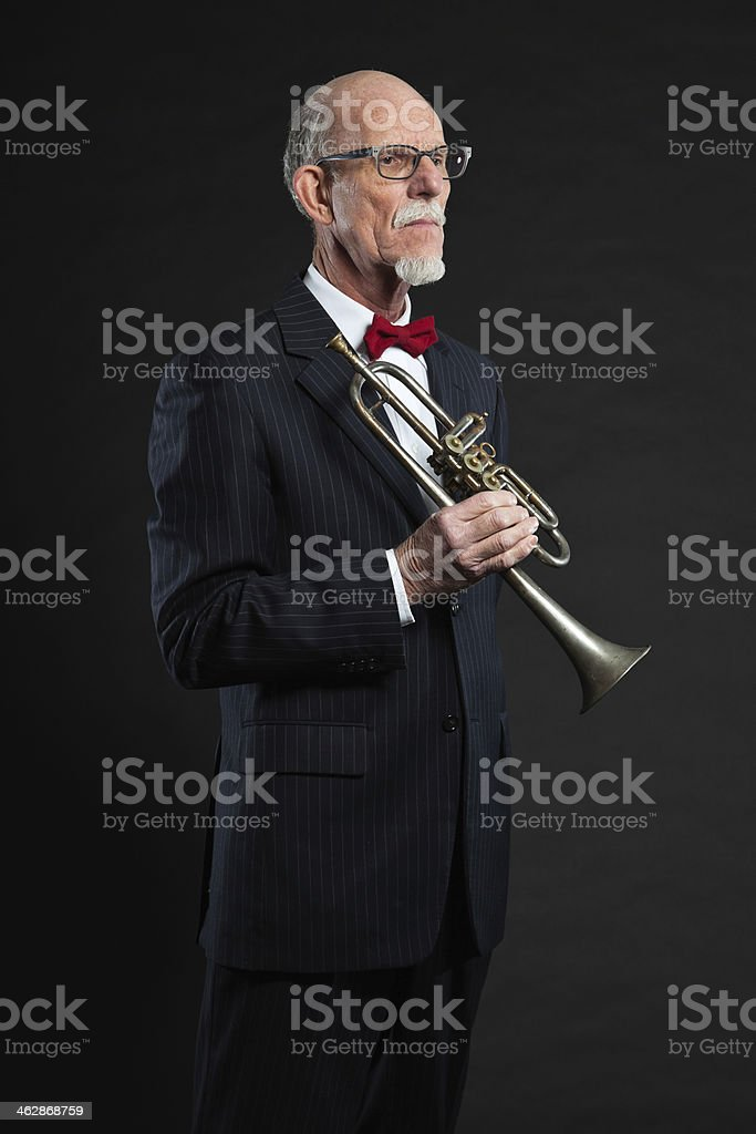 Senior jazz musician. Trumpet player. Studio shot. royalty-free stock photo