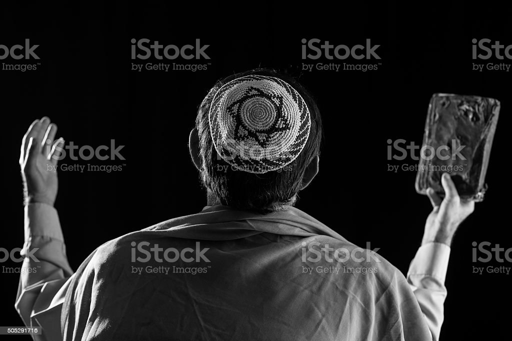 Senior jewish man praying ,holy book in hand stock photo