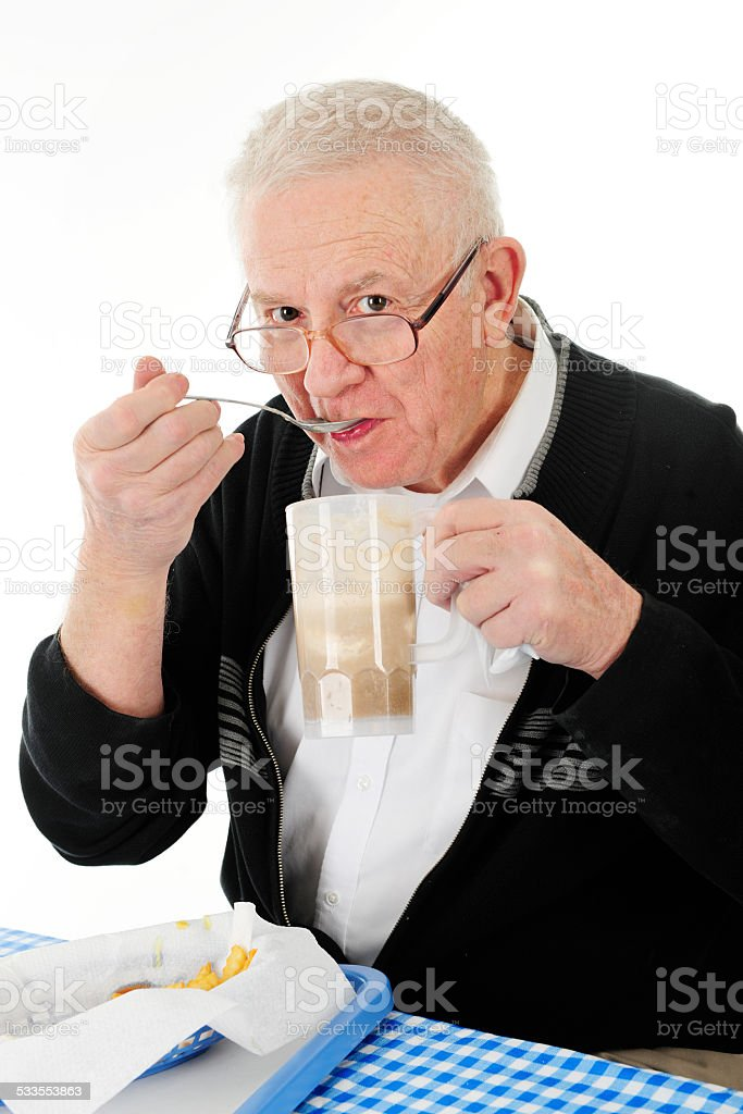 Senior Junk Food Junkie stock photo