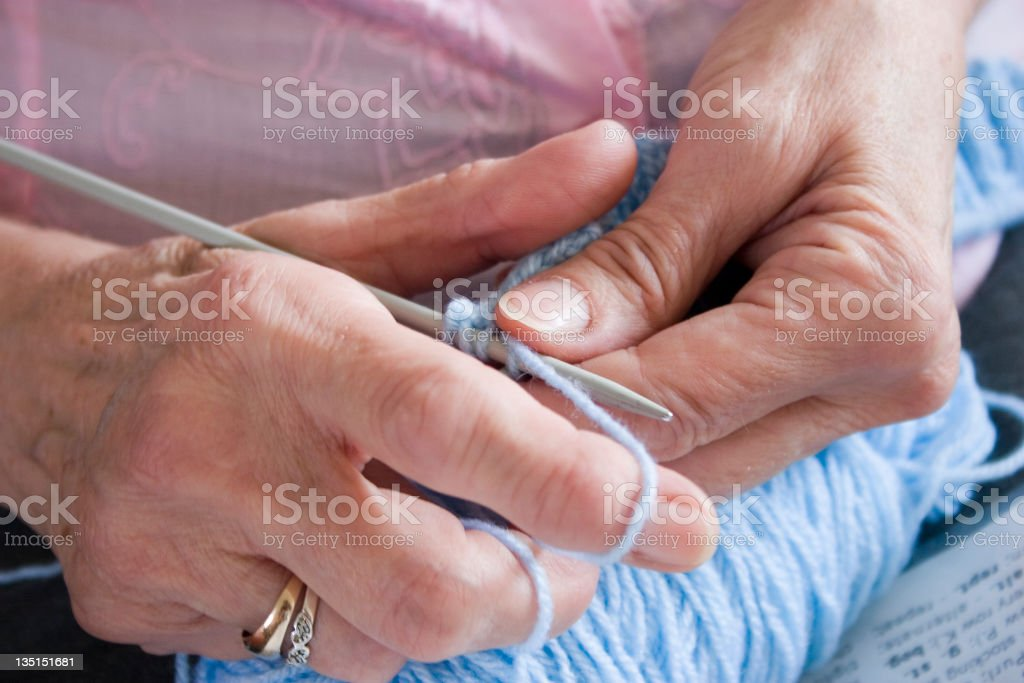 senior knitting close up with knitting needles and wool royalty-free stock photo