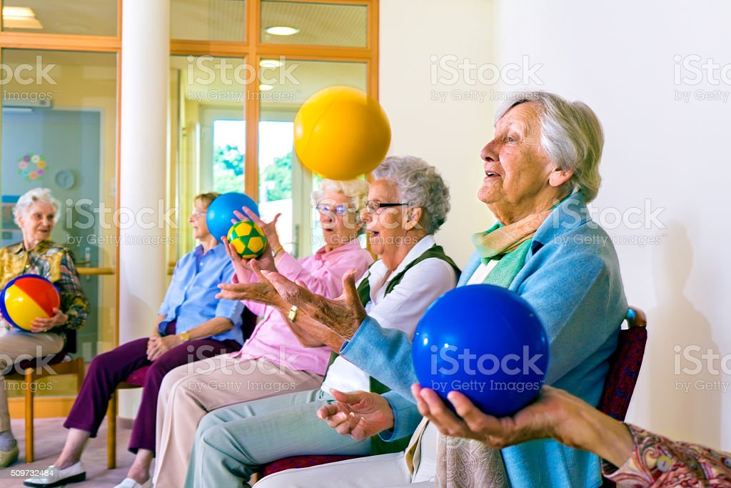 Senior ladies doing coordination exercises. stock photo