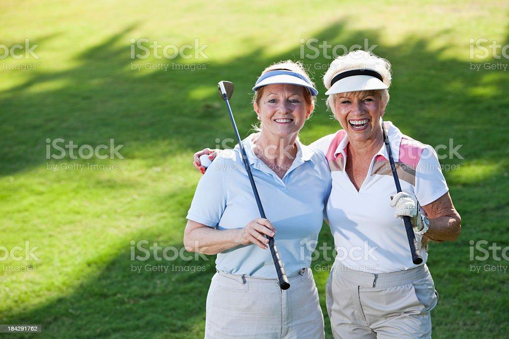 Senior ladies playing golf stock photo