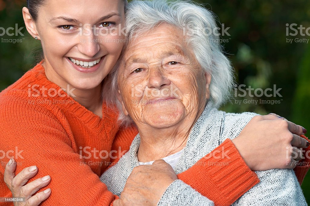 Senior lady and her granddaughter royalty-free stock photo