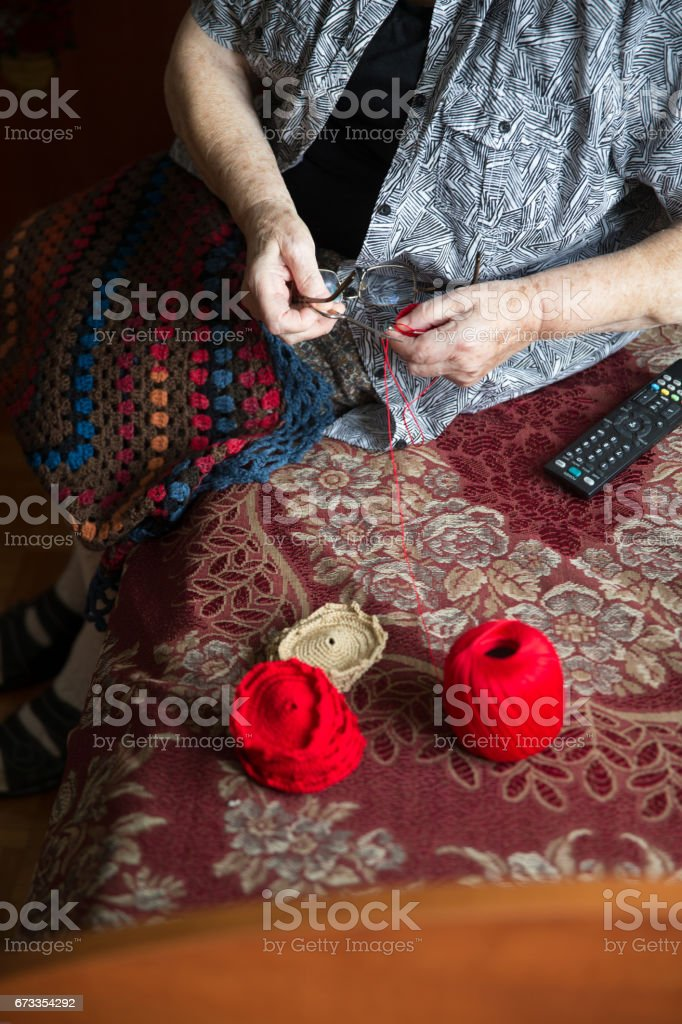 Senior Lady Crocheting in Her Room in Retire Community stock photo