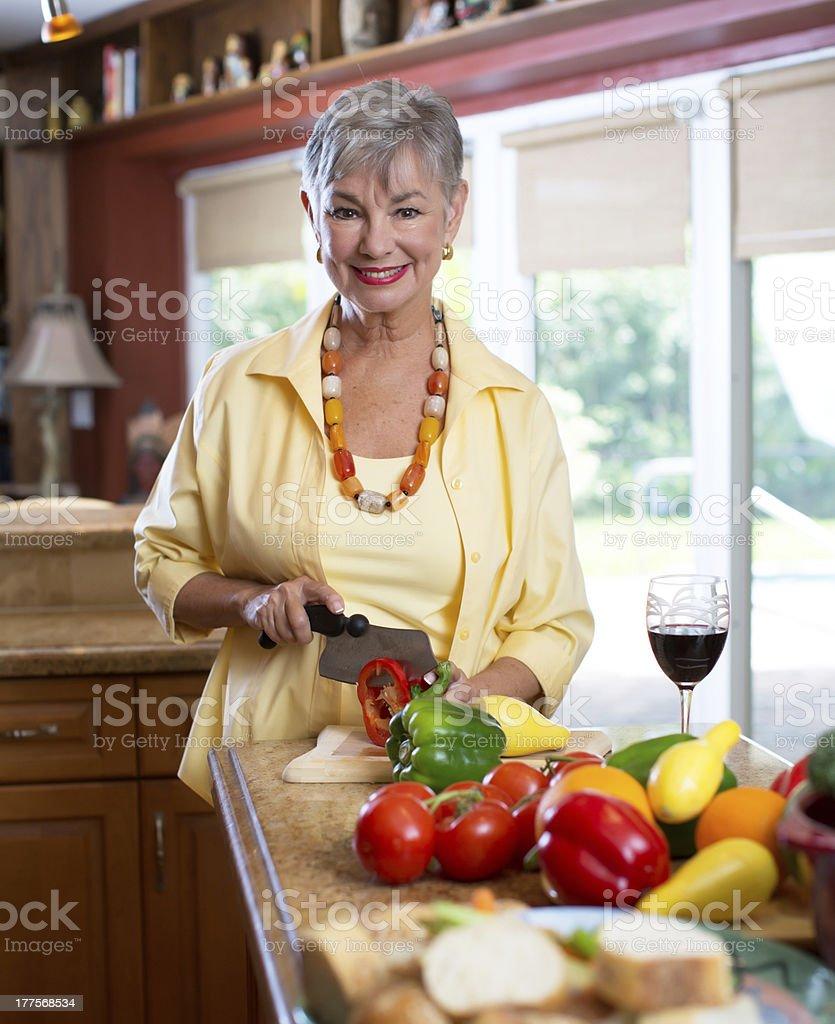 senior lady in the kitchen stock photo