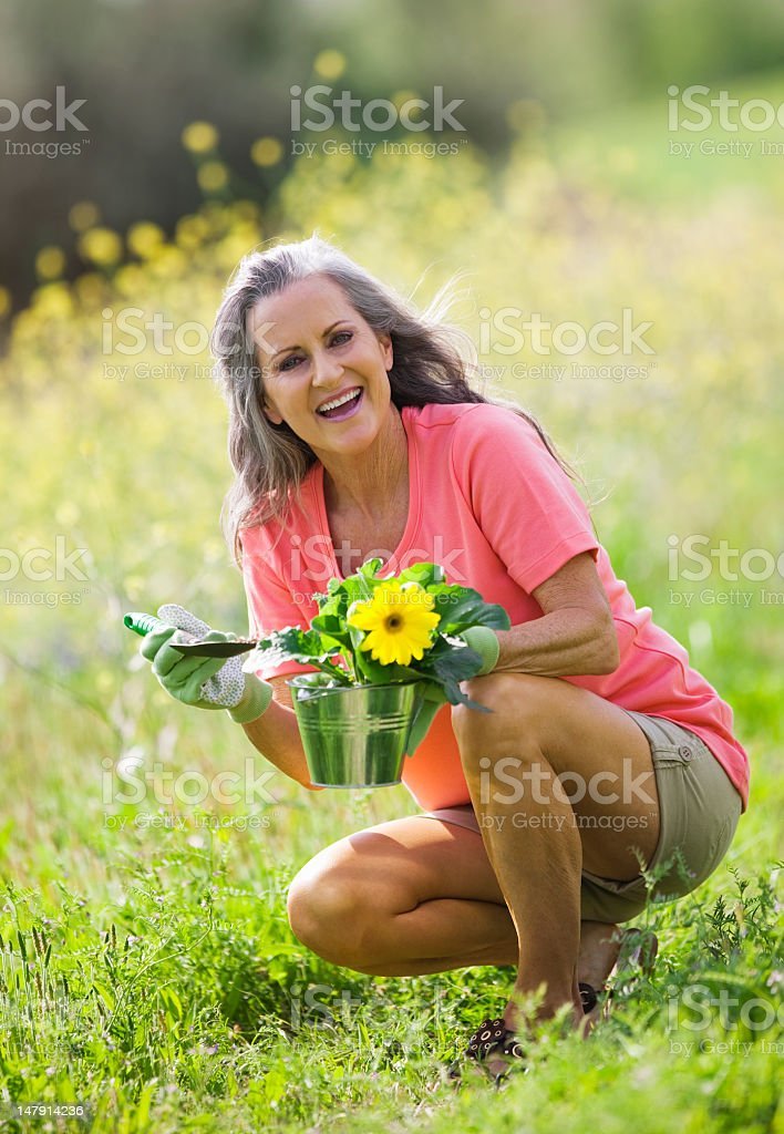 Senior Lady In Wildflower Field Laughing royalty-free stock photo